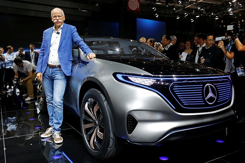 Dieter Zetsche, CEO of Daimler and Head of Mercedes-Benz, poses in front of a Mercedes EQ Electric car on media day at the Mondial de l'Automobile, the Paris auto show, in Paris, France, September 29, 2016. REUTERS/Jacky Naegelen